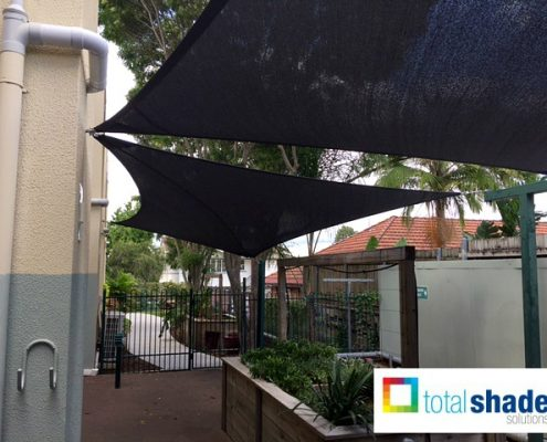 two shade sails over outdoor area lunch seating eating black workplace commercial sun protection shade uv prevention total shade solutions brisbane brendale