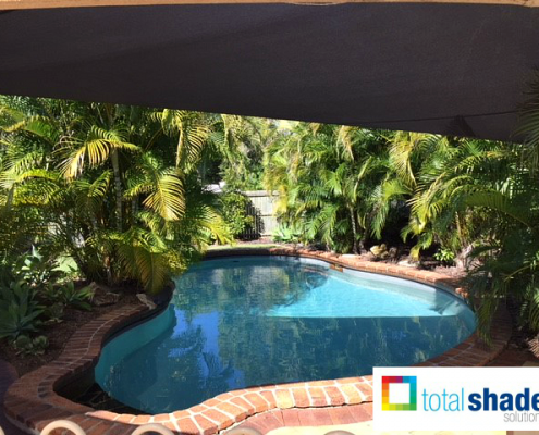 Shade sail over a pool sun protection summer hot uv keeping cool black charcoal outdoor space total shade solutions brisbane brendale