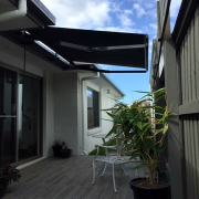 retractable awning over courtyard small area folding arm awning total shade solutions uv protection sun prevention overhead shade