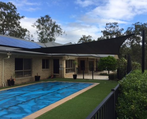 shade sail over pool total shade solutions brisbane queensland black posts replacement